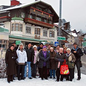 Tour group enjoying a Winter scene in front of Igls hotel