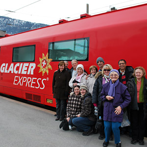 Tour group enjoying the Glacier Express on the Swiss Mountain Rails Tour