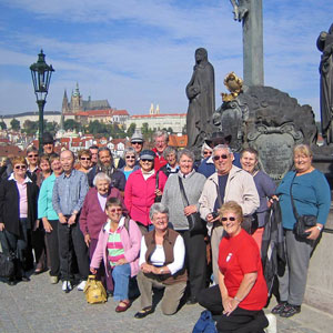 Tour group enjoying Charles Bridge, Prague