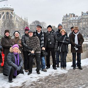 Tour group enjoying a Winter scene in front of Nortre Dame